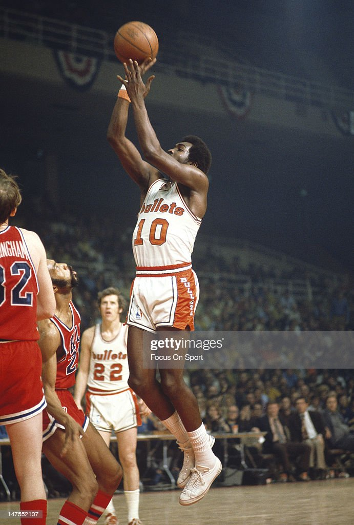 Earl Monroe of the Baltimore Bullets shoots over Archie Clark of the Philadelphia 76ers during an NBA basketball game circa 1970 at the Baltimore...
