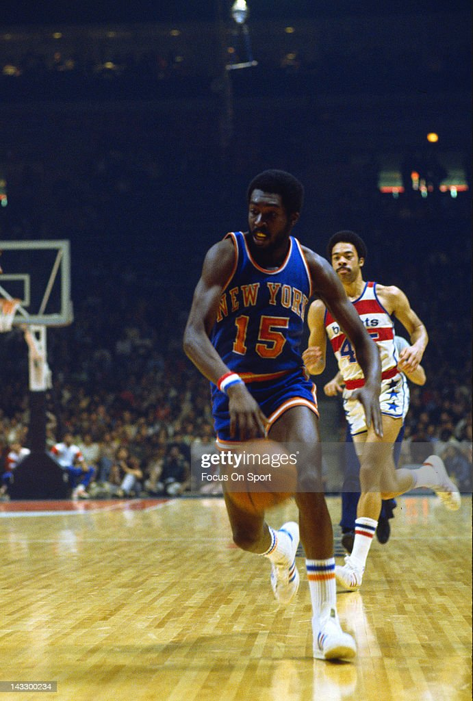 Earl Monroe of the New York Knicks dribbles the ball up court against the Washington Bullets during an NBA basketball game circa 1975 at the Capital...