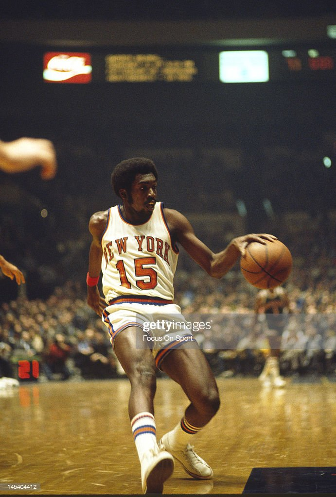 Earl Monroe of the New York Knicks dribbles the ball up court against the Milwaukee Bucks during an NBA basketball game circa 1973 at Madison Square...