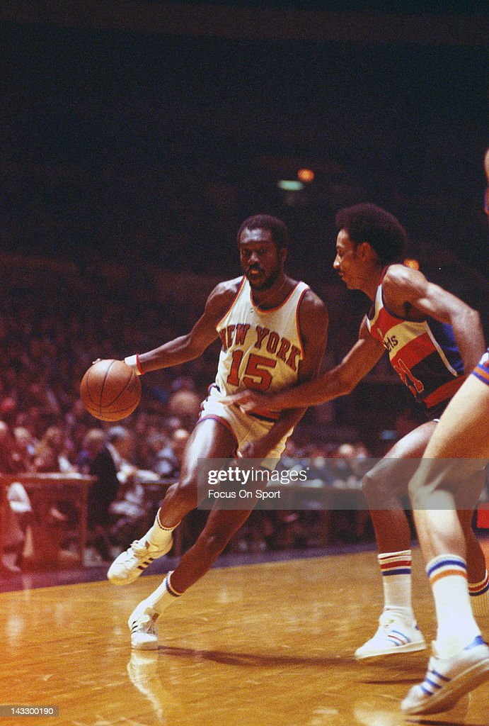 Earl Monroe of the New York Knicks drives on Dave Bing of the Washington Bullets during an NBA basketball game circa 1977 at Madison Square Garden in...