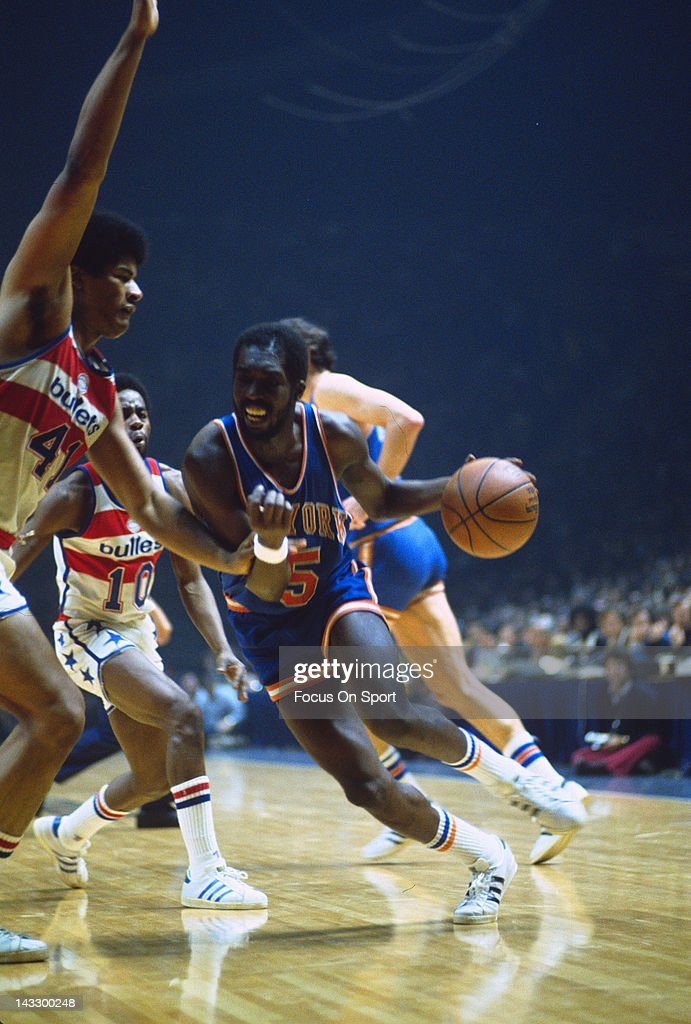 Earl Monroe of the New York Knicks drives on Wes Unseld of the Washington Bullets during an NBA basketball game circa 1975 at the Capital Centre in...