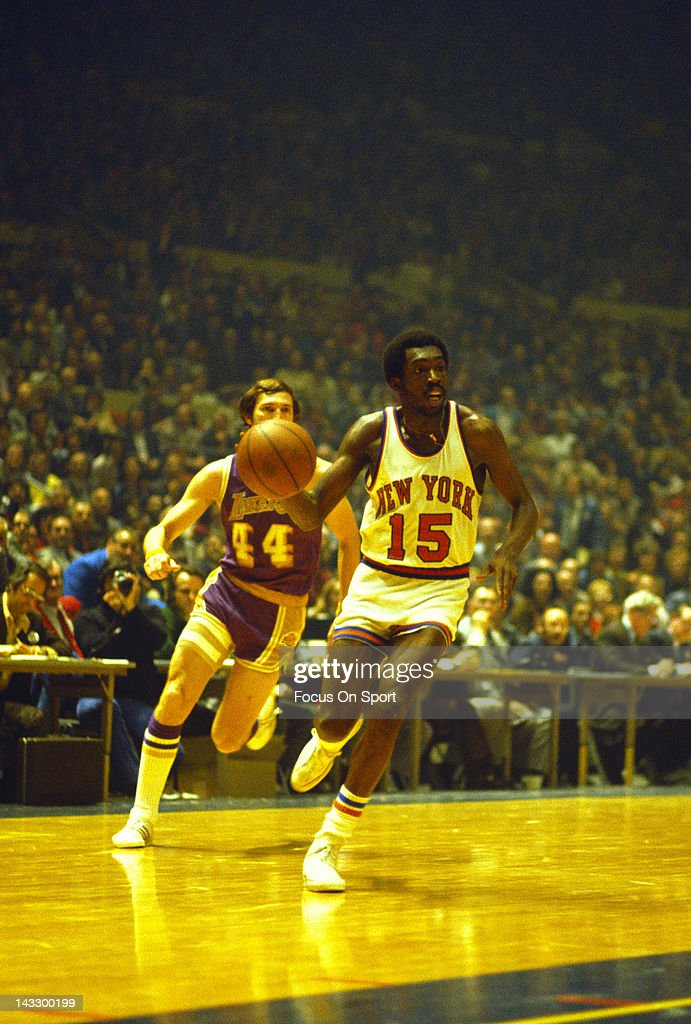 Earl Monroe of the New York Knicks drives to the basket pass Jerry West of the Los Angeles Lakers during an NBA basketball game circa 1973 at Madison...