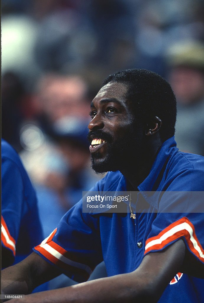 Earl Monroe of the New York Knicks looks on from the bench against the Washington Bullets during an NBA basketball game circa 1977 at the Capital...