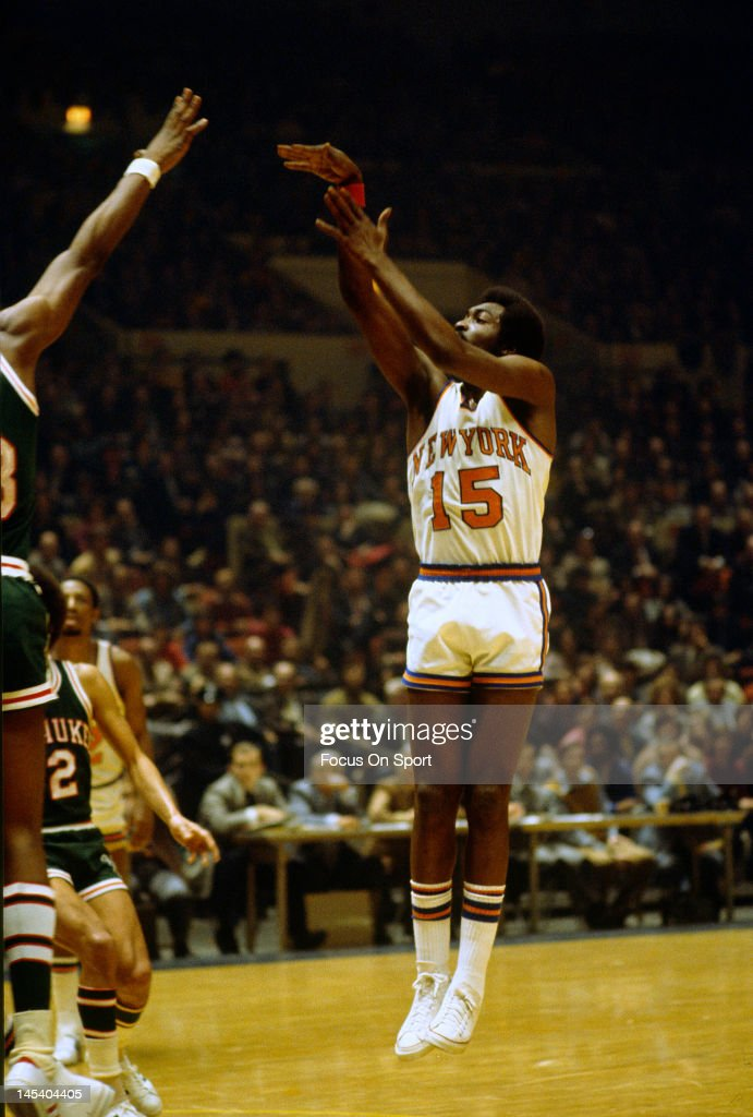 Earl Monroe of the New York Knicks shoots against the Milwaukee Bucks during an NBA basketball game circa 1973 at Madison Square Garden in the...