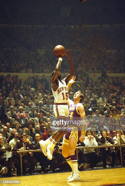 Earl Monroe of the New York Knicks shoots over Jerry West of the Los Angeles Lakers during an NBA basketball game circa 1973 at Madison Square Garden...