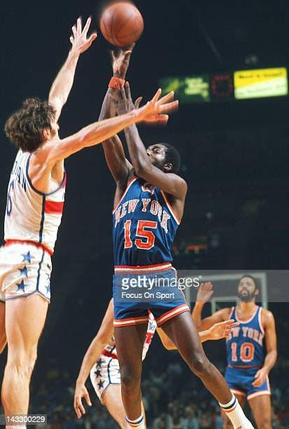 Earl Monroe of the New York Knicks shoots over Mike Riordan of the Washington Bullets during an NBA basketball game circa 1975 at the Capital Centre...