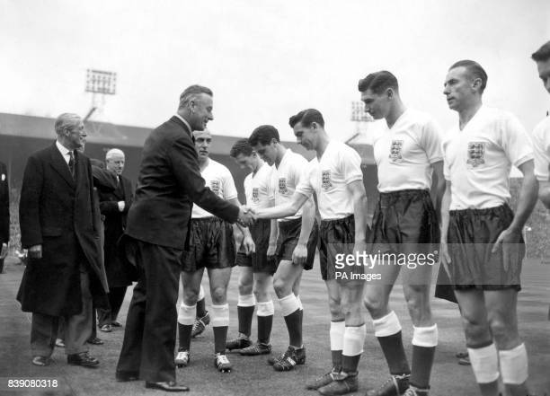 Earl Mountbatten of Burma of shakes hands with English footballer Johnny Haynes as he goes down the line of the English team which includes Stanley...