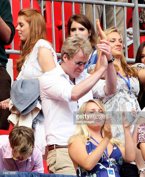 Earl Spencer brother of the late Princess Diana and princesses Beatrice and Eugenie watche the Concert for Diana at Wembley Stadium on July 1 2007 in...
