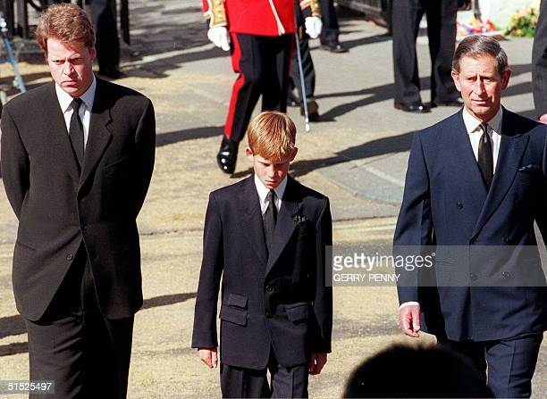 Earl Spencer Diana's brother Prince Harry her son and Prince Charles her former husband join the gun carriage carrying the coffin of Princess of...