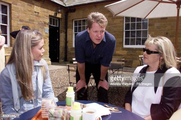 Earl Spencer talks to members of the public Amy Warren and her mother Jenny Warren from Nottingham in the court yard of the family Home Althorp near...