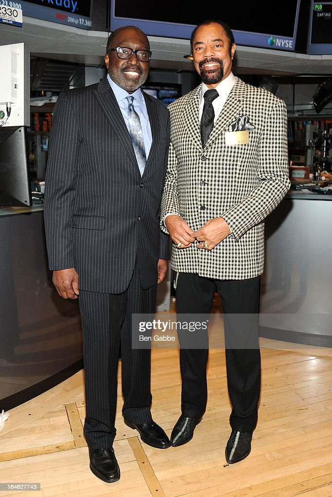 Earl 'The Pearl' Monroe (L) and Walt 'Clyde' Frazier visit the New York Stock Exchange and Ring The Closing Bell to Highlight the Crown Heights Youth Collective on March 25, 2013 in New York City.