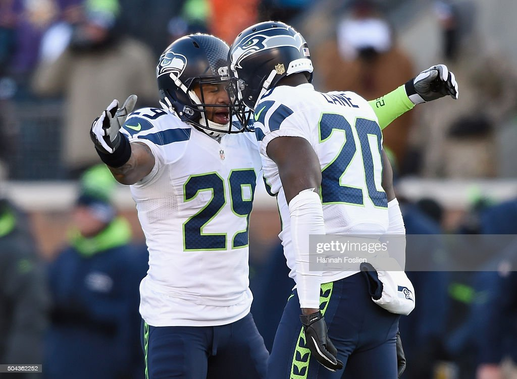 Earl Thomas #29 of the Seattle Seahawks and Jeremy Lane #20 celebrate after Lane broke up a pass in the fourth quarter against the Minnesota Vikings during the NFC Wild Card Playoff game at TCFBank Stadium on January 10, 2016 in Minneapolis, Minnesota.