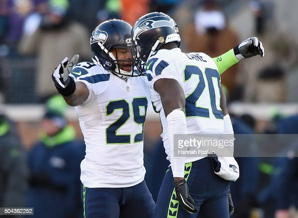 Earl Thomas of the Seattle Seahawks and Jeremy Lane celebrate after Lane broke up a pass in the fourth quarter against the Minnesota Vikings during...