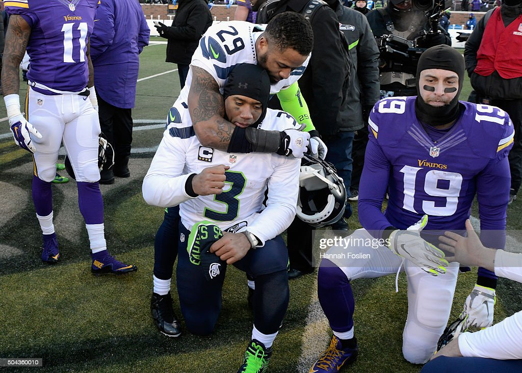 Earl Thomas #29 of the Seattle Seahawks and Russell Wilson #3 react after defeating the Minnesota Vikings with a score of 10 to 9 during the NFC Wild Card Playoff game at TCFBank Stadium on January 10, 2016 in Minneapolis, Minnesota.