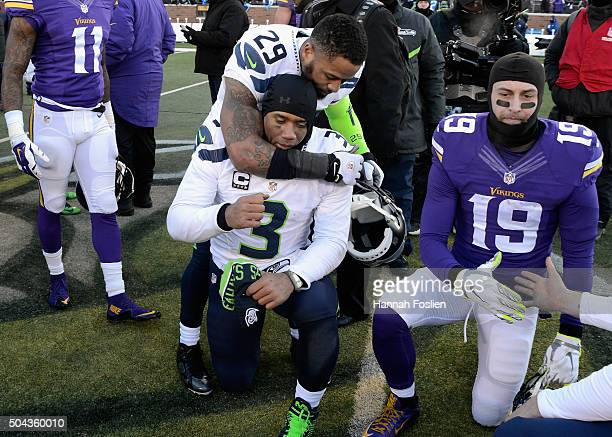 Earl Thomas of the Seattle Seahawks and Russell Wilson react after defeating the Minnesota Vikings with a score of 10 to 9 during the NFC Wild Card...