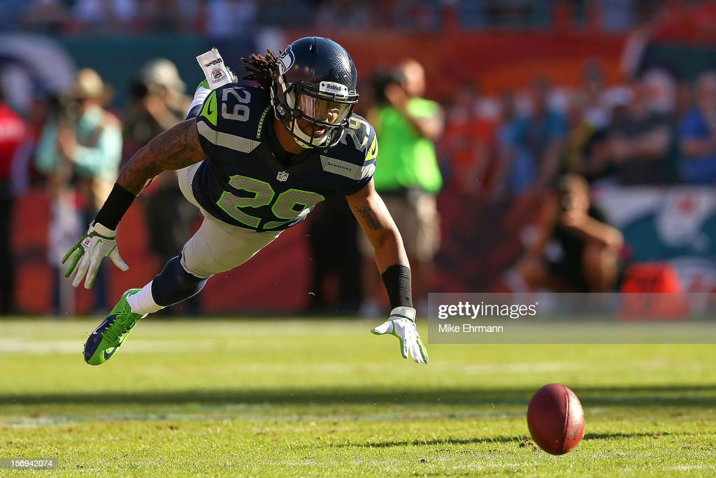 Earl Thomas #29 of the Seattle Seahawks misses a interception during a game against the Seattle Seahawks at Sun Life Stadium on November 25, 2012 in Miami Gardens, Florida.