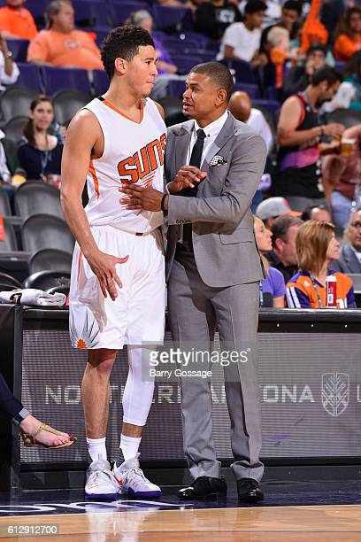 Earl Watson head coach of the Phoenix Suns and Devin Booker talk in the third quarter against the Utah Jazz on October 5 at Talking Stick Resort...