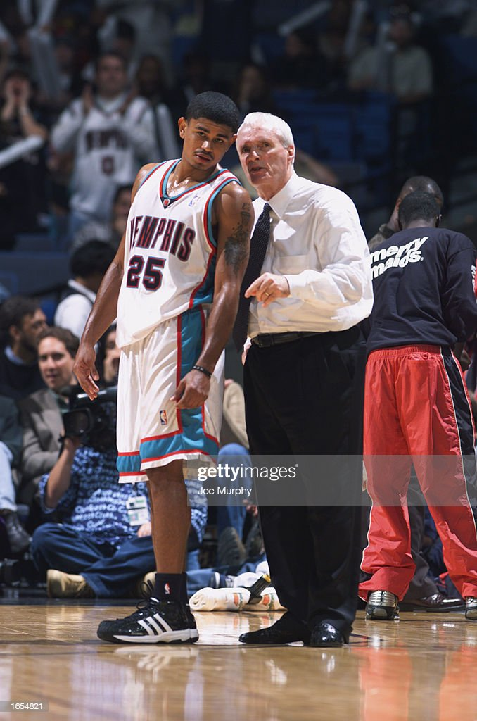 Earl Watson #25 of the Memphis Grizzlies listens to instructions by Head Coach Hubie Brown during the NBA game against the Minnesota Timberwolves at The Pyramid on November 15, 2002 in Memphis, Tennessee. The Timberwolves won 99-95.