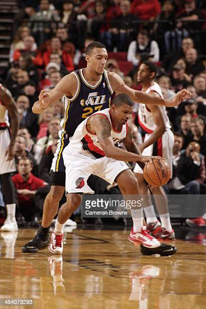 Earl Watson of the Portland Trail Blazers controls the ball against Rudy Gobert of the Utah Jazz on December 6 2013 at the Moda Center Arena in...