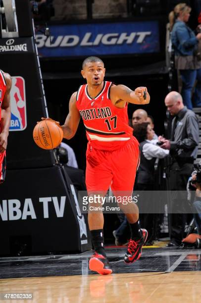 Earl Watson of the Portland Trail Blazers drives handles the ball against the San Antonio Spurs at the ATT Center on March 12 2014 in San Antonio...