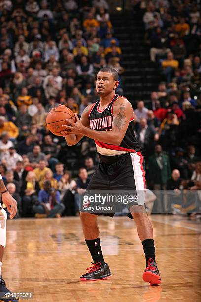 Earl Watson of the Portland Trail Blazers passes the ball against the Indiana Pacers on February 7th 2014 at the Bankers Life Fieldhouse in...