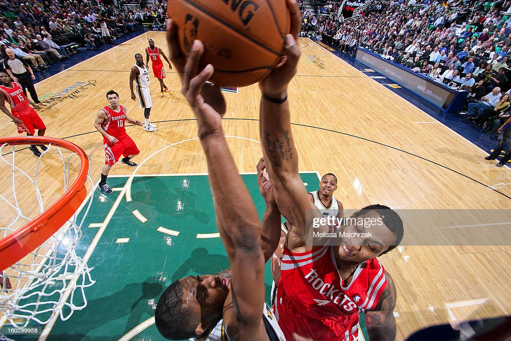 Earl Watson #11 of the Utah Jazz blocks Greg Smith #4 of the Houston Rockets at Energy Solutions Arena on January 28, 2013 in Salt Lake City, Utah.