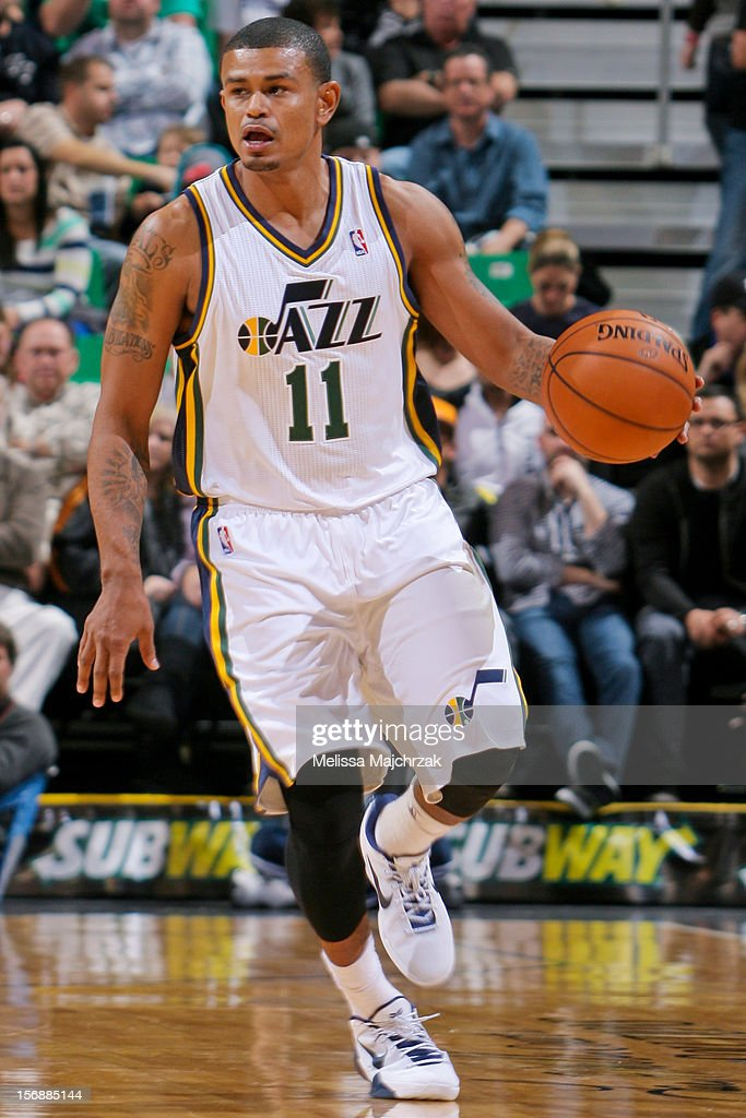 <a gi-track='captionPersonalityLinkClicked' href=/galleries/search?phrase=Earl+Watson&family=editorial&specificpeople=201841 ng-click='$event.stopPropagation()'>Earl Watson</a> #11 of the Utah Jazz brings the ball up court during his season debut against the Sacramento Kings at Energy Solutions Arena on November 23, 2012 in Salt Lake City, Utah.