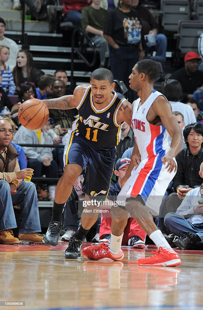 Earl Watson #11 of the Utah Jazz drives against Brandon Knight #7 of the Detroit Pistons on January 12, 2013 at The Palace of Auburn Hills in Auburn Hills, Michigan.