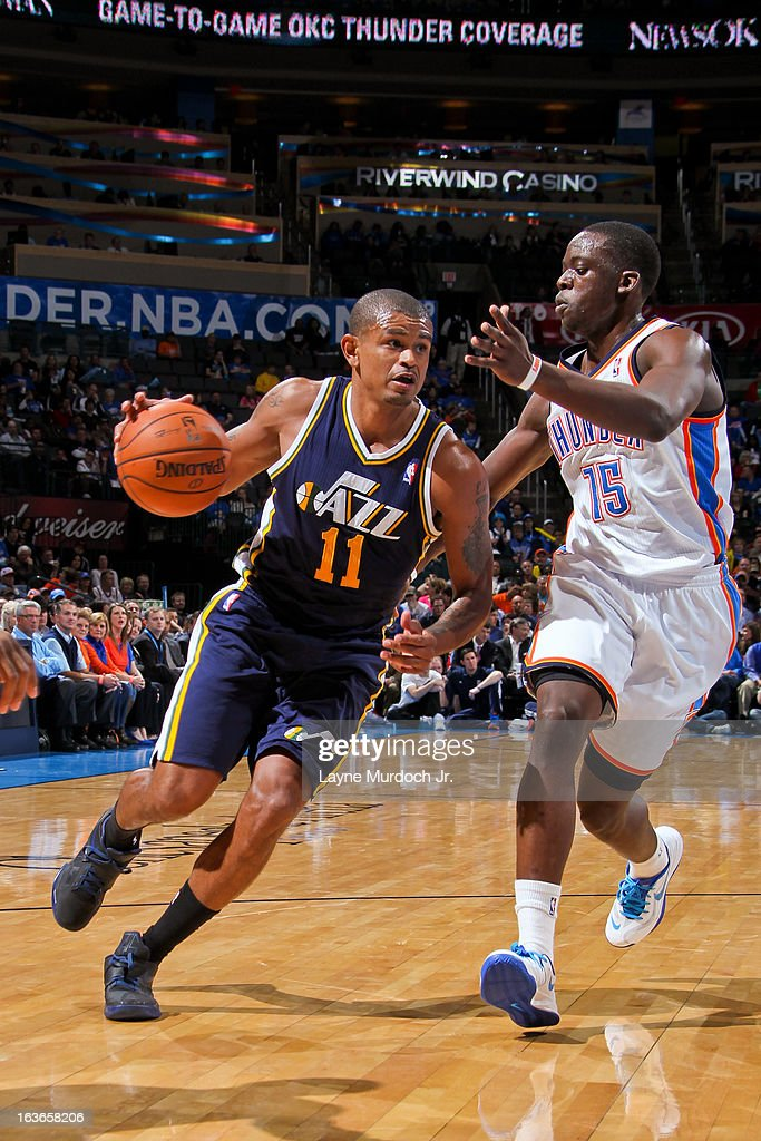 Earl Watson #11 of the Utah Jazz drives against Reggie Jackson #15 of the Oklahoma City Thunder on March 13, 2013 at the Chesapeake Energy Arena in Oklahoma City, Oklahoma.