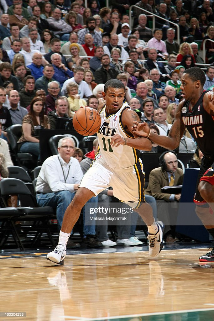 Earl Watson #11 of the Utah Jazz drives to the basket against the Miami Heat at Energy Solutions Arena on January 14, 2013 in Salt Lake City, Utah.