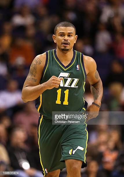 Earl Watson of the Utah Jazz during the NBA game against the Phoenix Suns at US Airways Center on December 14 2012 in Phoenix Arizona NOTE TO USER...