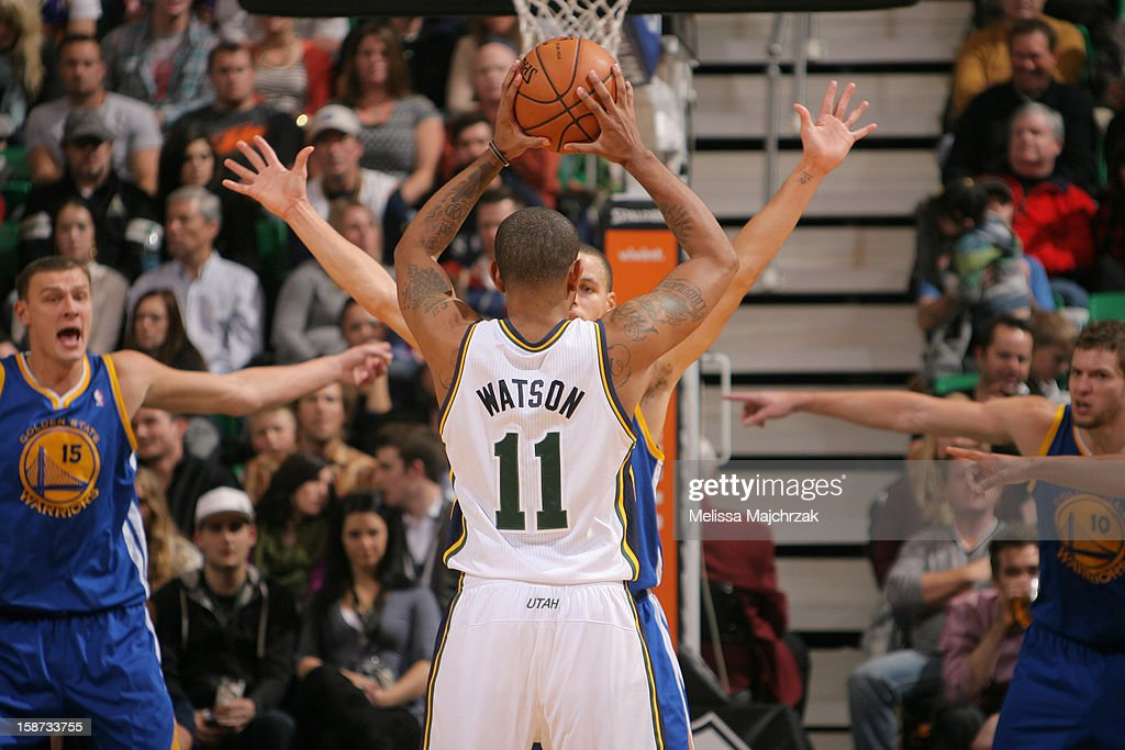 <a gi-track='captionPersonalityLinkClicked' href=/galleries/search?phrase=Earl+Watson&family=editorial&specificpeople=201841 ng-click='$event.stopPropagation()'>Earl Watson</a> #11 of the Utah Jazz look to pass the ball against Stephen Curry #30 of the Golden State Warriors at Energy Solutions Arena on December 26, 2012 in Salt Lake City, Utah.