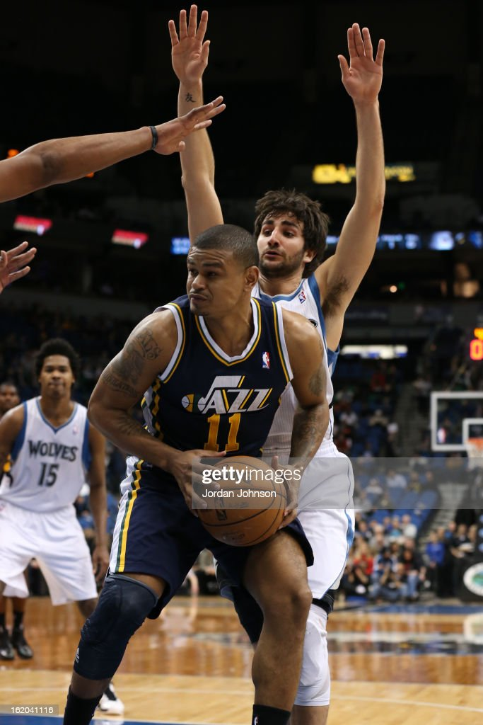 <a gi-track='captionPersonalityLinkClicked' href=/galleries/search?phrase=Earl+Watson&family=editorial&specificpeople=201841 ng-click='$event.stopPropagation()'>Earl Watson</a> #11 of the Utah Jazz looks to score against the Minnesota Timberwolves on February 13, 2013 at Target Center in Minneapolis, Minnesota.