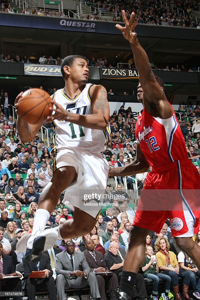 Earl Watson #11 of the Utah Jazz passes away from Eric Bledsoe #12 of the Los Angeles Clippers at Energy Solutions Arena on December 03, 2012 in Salt Lake City, Utah.