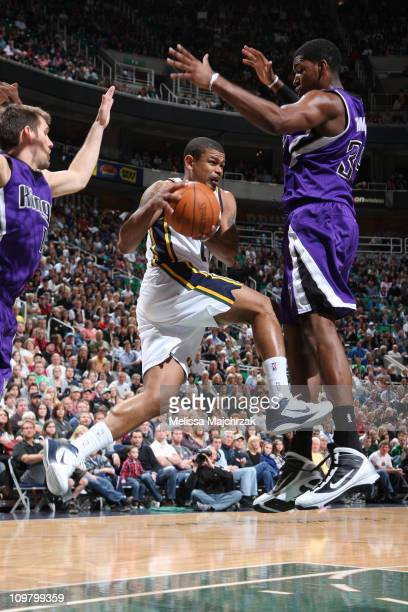 Earl Watson of the Utah Jazz prepares to pass the ball around Jason Thompson of the Sacramento Kings at EnergySolutions Arena on March 5 2011 in Salt...