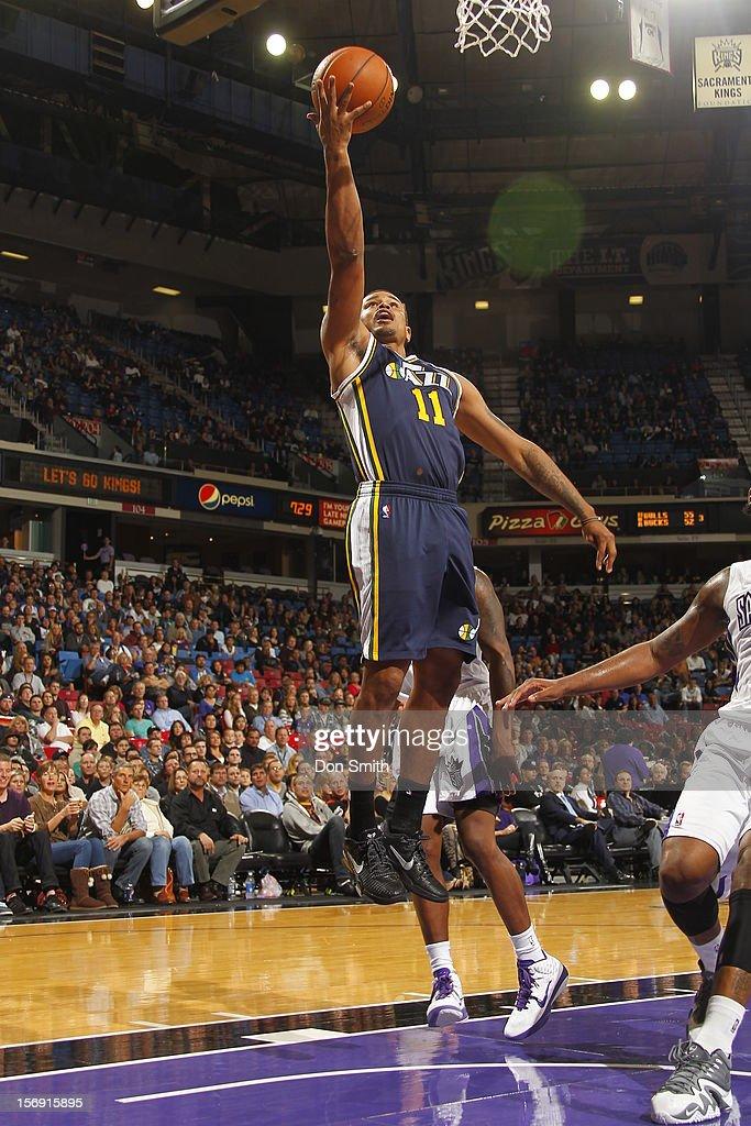 Earl Watson #11 of the Utah Jazz shoots the ball against the Sacramento Kings on November 24, 2012 at Sleep Train Arena in Sacramento, California.