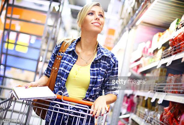 Early 30's woman shopping in supermarket.
