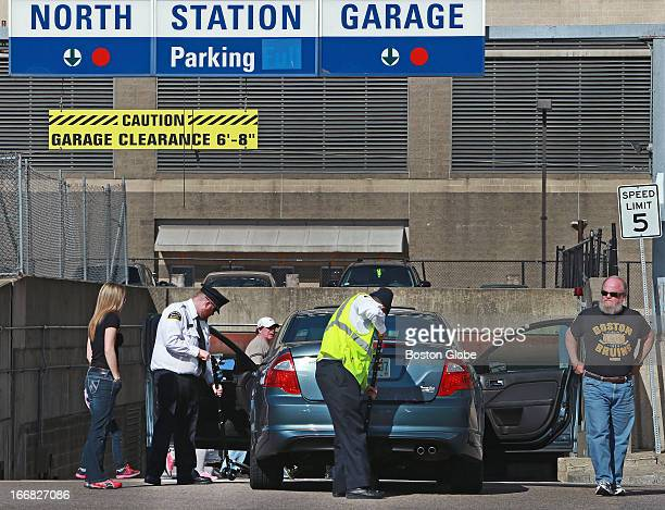 Early arrivals to the North Station Garage under the TD Garden were asked to get out of their cars as security people checked out under the vehicle...