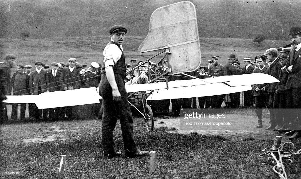 Early Aviation, 25th July 1909, The historic first coss-channel flight (France to England) by Louis Bleriot in his monoplane, Crowds surround the aircraft after his landing at Dover in the South of England
