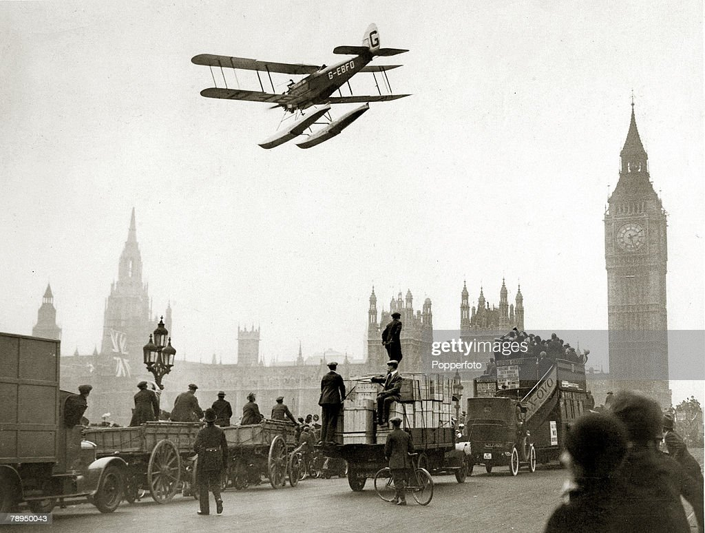 March 1926 British aviatorAlan Cobham flying over Westminster London at the final minutes of his epic 27000 mile flight to Australia and back stops...