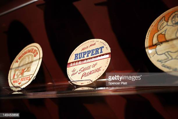 Early beer coasters are viewed at the new exhibition at the New York Historical Society called Beer Here Brewing New York's History on May 30 2012 in...