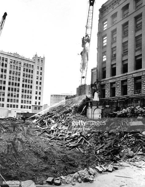 Early Downtown Building Heads For Limbo The sixstory Johnson Building at 17th Street and Glenarm Place nears extinction under the wrecker's crane to...