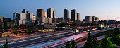 The light of dawn begins to illuminate the buildings and architecture of Bellevue Washington