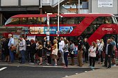 Early morning commuters form queues to board buses at Victoria station during a tube strike in London on July 9 2015 London's roads buses and...