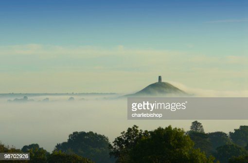 Early morning fog rolling in over Glastonbury Tor