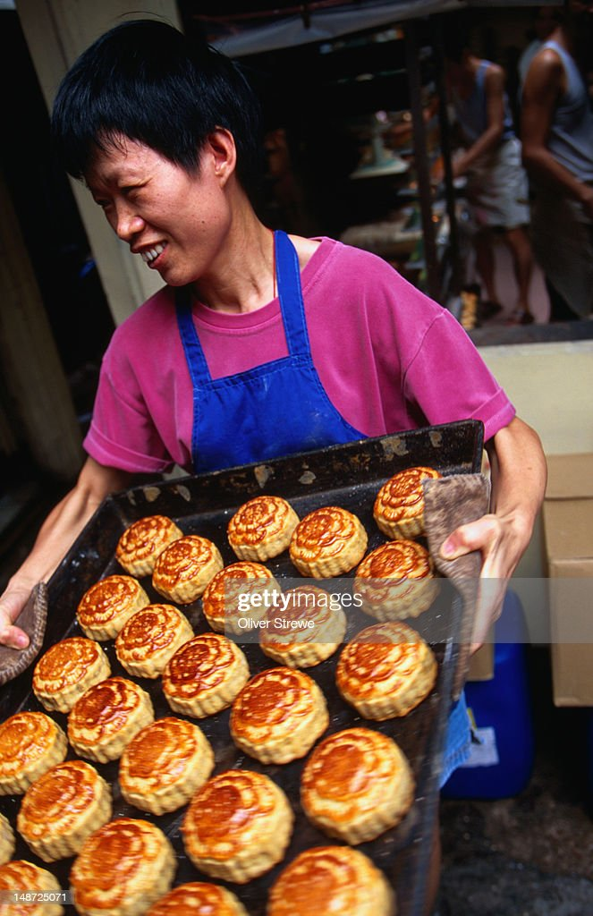 Early morning in a bakery making moon cakes for the Moon Festival on Hong Kong Island : Stock Photo