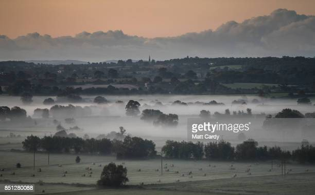 Early morning mist lingers in fields as the autumn sun rises over the Somerset Levels near Glastonbury on September 22 2017 in Somerset England Today...