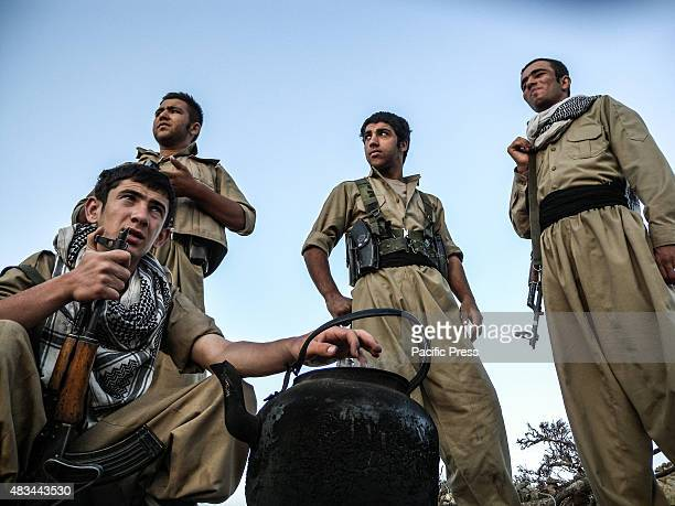 Early morning Peshmergas gather around a tea pot The PDKI movement is in Iranian borders one kilometer away from the Iranian troops and where the...