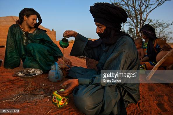 Early morning scenes at a Baptism in a Tuareg Nomad camp on October 11 2009 in Ingal Niger Tuareg Baptism is very simple three names are discussed by...