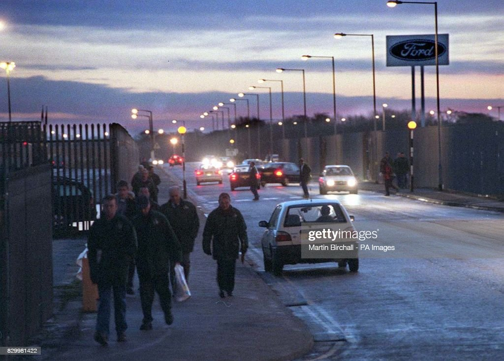 Early morning shift workers arrive at the Ford Halewood plant in Merseyside, today (Tuesday), to await the announcement of the mini Jaguar car production later today. See PA Story TRANSPORT Jaguar. Photo by Martin Birchall/PA.